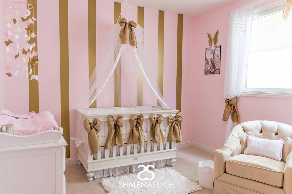 The Nursery Turned Out Y And Feminine Featuring White Baby Bedding Decor Items In Pink Gold Erfly Mobile Angel Wings
