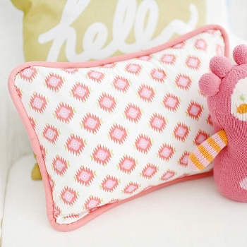 Coral and Gold Tribal Pillow | Aztec Baby in Coral Crib Collection