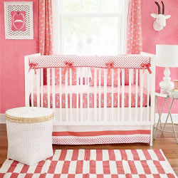 Coral Animal Print Crib Rail Cover  |  Zebra Parade in Coral Crib Collection