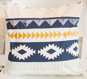 Navy and Gold Aztec Pillow | Arid Horizon Crib Collection