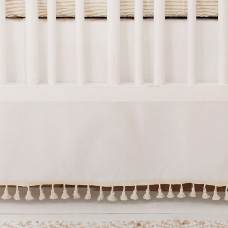 White Nursery Crib Skirt with Tassels | Gold Dust and Young & Brave Collections