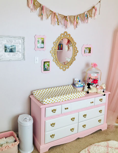 white nursery dresser and changing pad