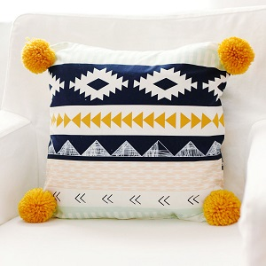 Navy and Gold Aztec Pillow with Pom Poms | Arid Horizon Crib Collection