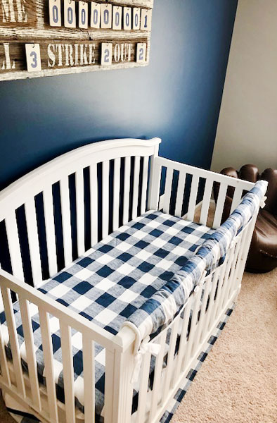 white crib and baby bedding