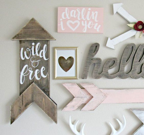 Nursery gallery wall nursery gallery wall ideas nursery wall decor arrows are hot in the nursery and we are smitten with this nursery wall filled with pink white and rustic arrows ppazfo
