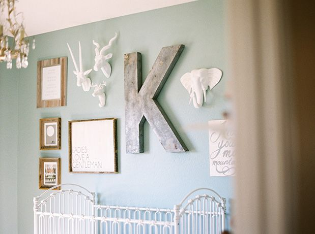 The Gallery Wall In This Nursery Is To For Large Metal K Rustic Wood Frames And Simple White Animal Heads Coordinate So Well Together On