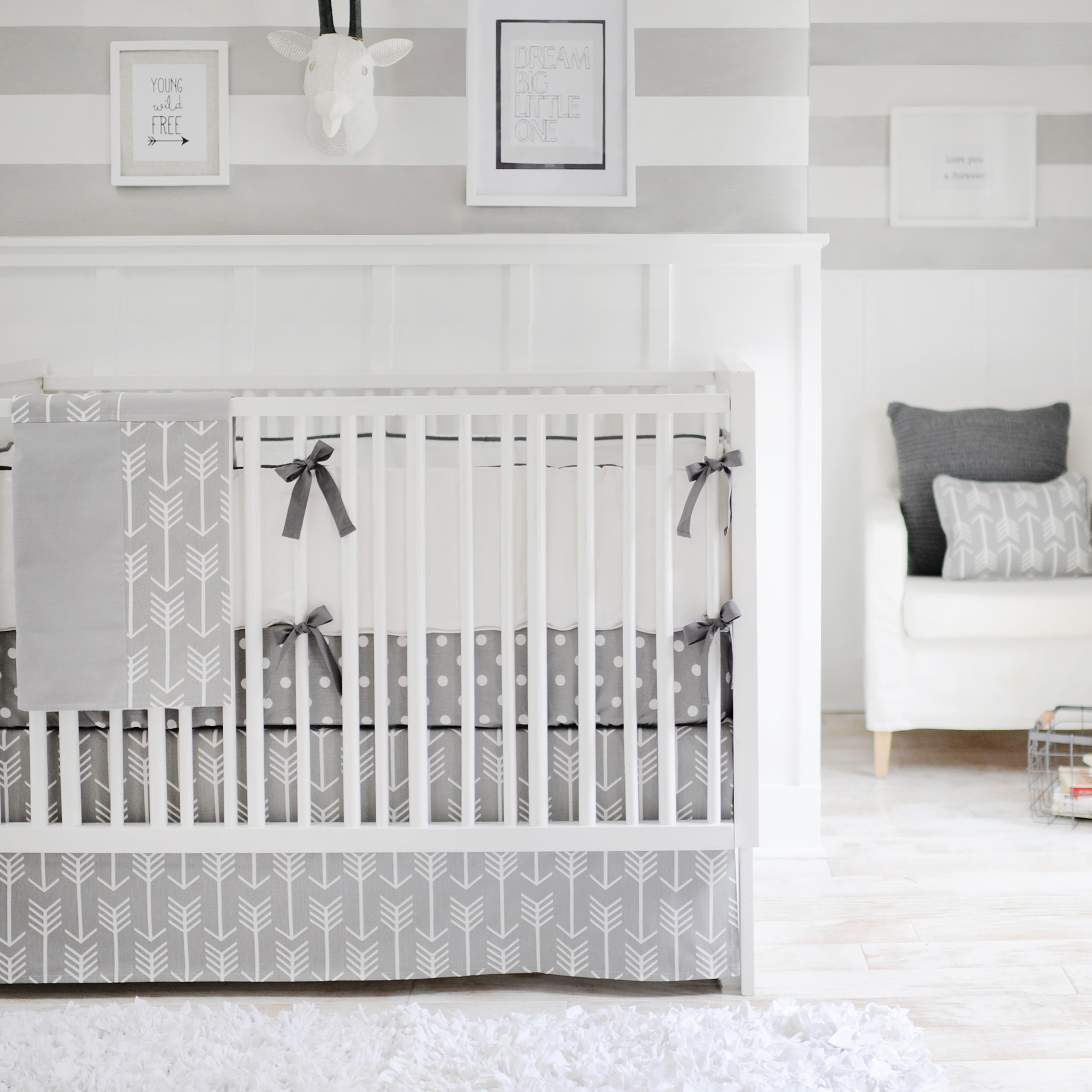 A Simple Crib And Striped Sheet Makes This Nursery Neutral