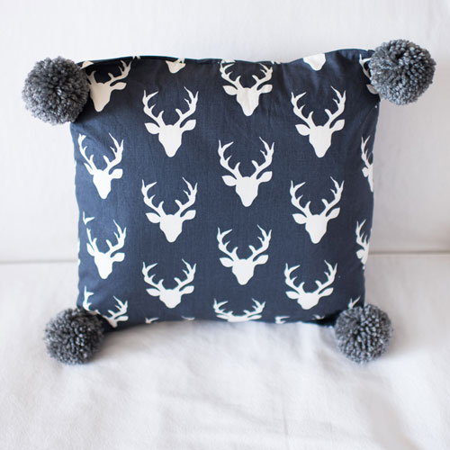 Navy Deer Pillow with Pom Poms | Buck Forest in Twilight Crib Collection