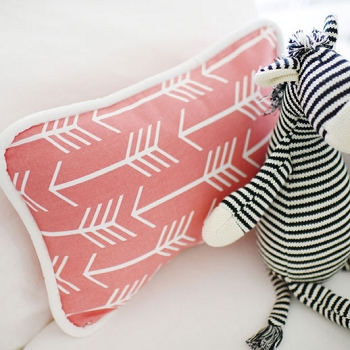 Arrow Pillow | Wanderlust in Coral Crib Collection