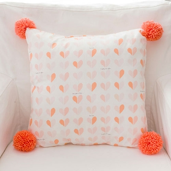 Peach Heart Nursery Pillow with Pom Poms | Once Upon a Time Crib Collection