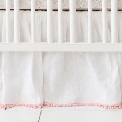 White Linen Ruffled Crib Skirt with Pink Pom Poms